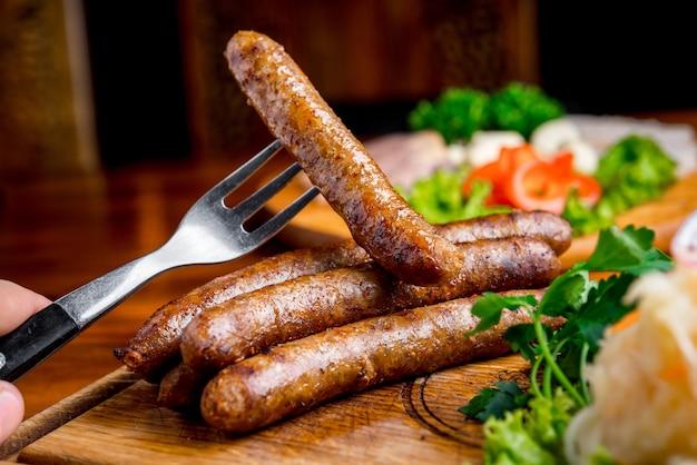 Fried sausage with sauerkraut and mustard sauce
