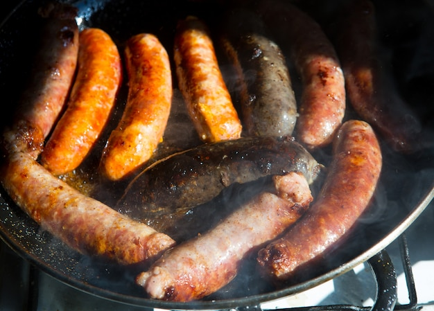 Fried sausages sausages black pudding and chorizo