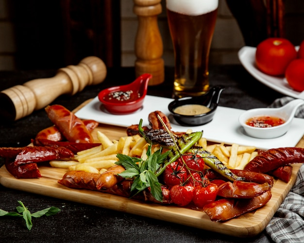 Fried sausages with fries and beer