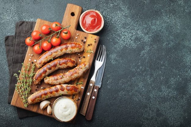 Fried sausages with sauces.
