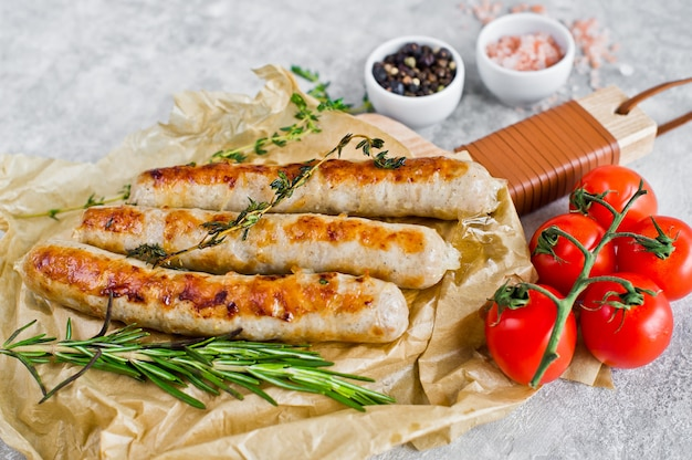 Fried sausages on a wooden chopping board