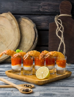 Fried shrimp cocktail shots filled with mayonnaise and sweet chili sauce