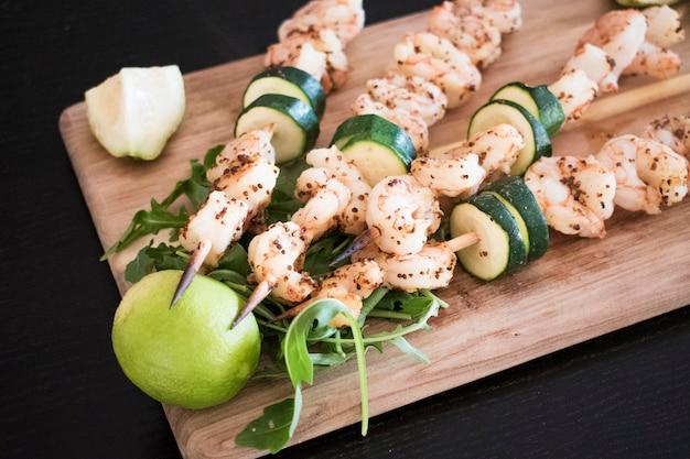Fried shrimp kebabs with vegetables