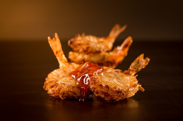 Fried shrimp with sauce in a dark ambient