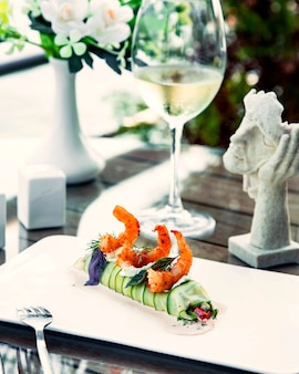 Fried shrimps with cucumber rolls