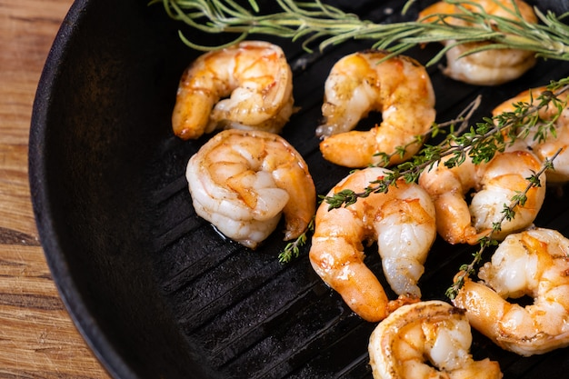Fried shrimps with herbs, close up view.