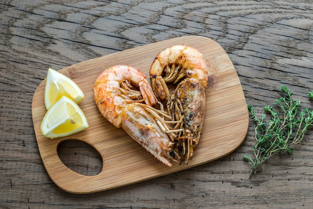Fried shrimps on wooden table