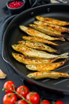 Fried smelt in a pan.
