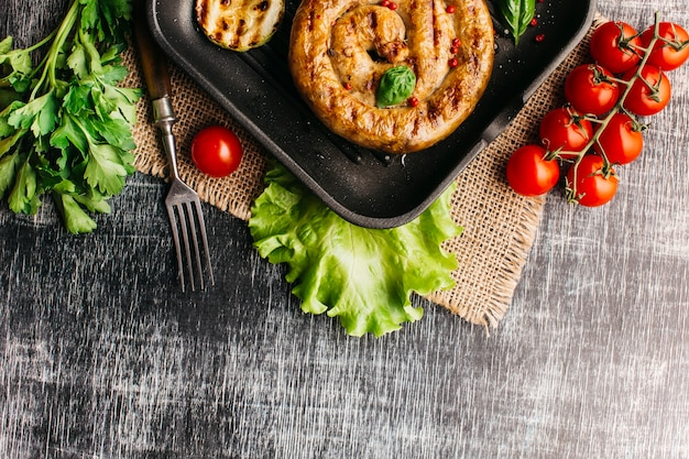 Fried snail sausage with spices in pan