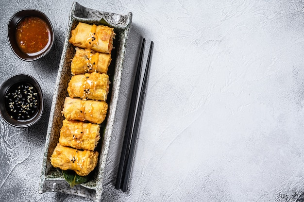 Fried spring rolls. white background. traditional chinese cuisine. top view. copy space
