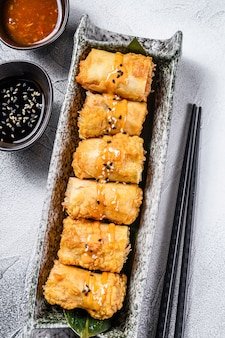 Fried spring rolls. white background. traditional chinese cuisine. top view