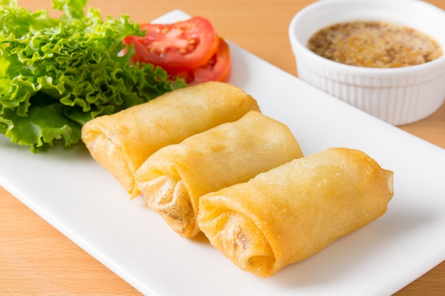 Fried spring rolls on white plate