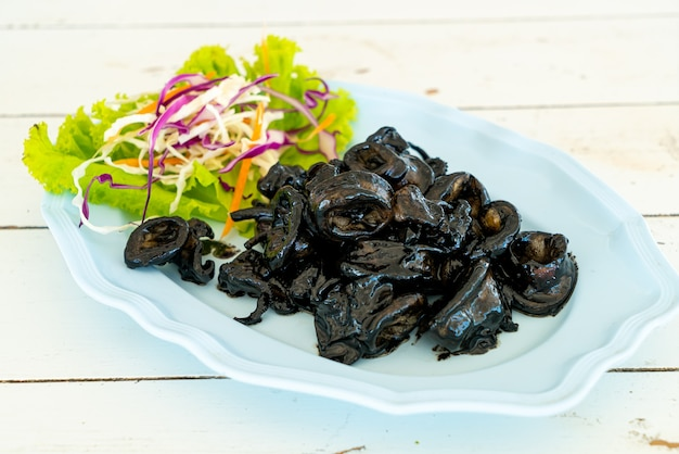 Fried squid with squid ink sauce - seafood style