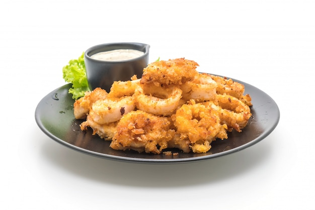 Fried squids or octopus (calamari) with sauce