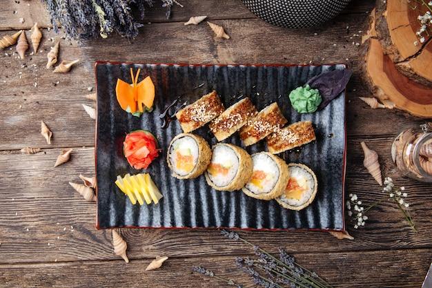Fried sushi rolls with avocado salmon