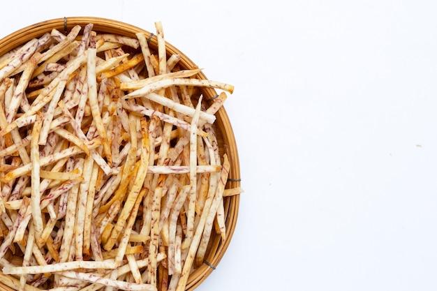 Fried taro sticks in bamboo basket