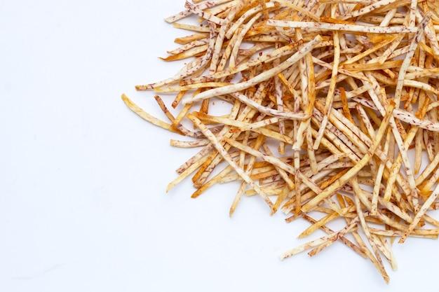 Fried taro sticks on white background.