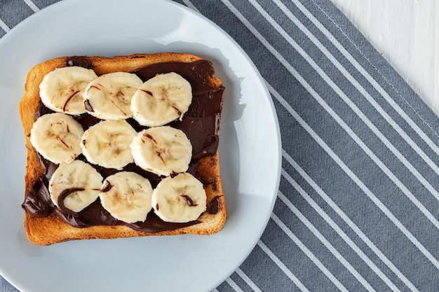 Fried toast with chocolate paste and banana slices