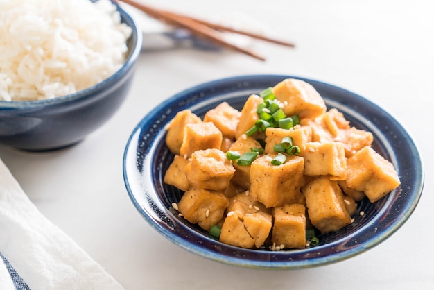Fried tofu in a bowl with sesame
