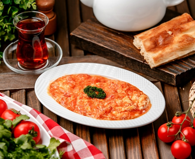 Fried tomatoes with eggs on the table