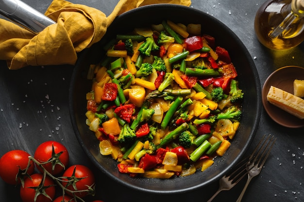 Fried vegetables with sauce on pan