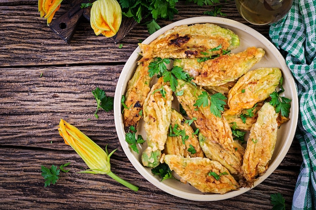 Fried zucchini flowers stuffed with ricotta and green herbs