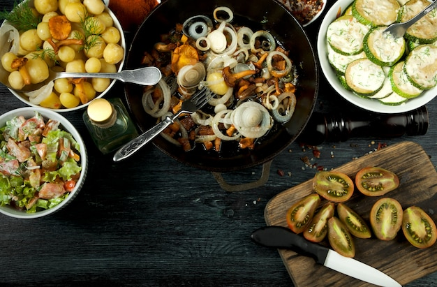 Fried zucchini, young boiled potatoes with dill and fried chanterelle mushrooms with golden onions