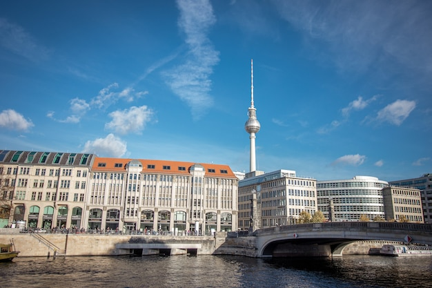 Friedrichs bridge over spree river and berlin tv tower in germany.