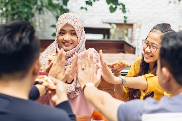 Friend giving high five at cafe