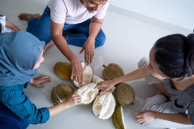 Friend sharing and eat durian fruits