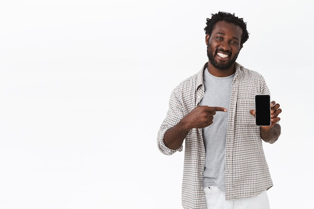 Friendly african-american handsome guy in checked shirt