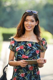 Friendly asian lady with tablet