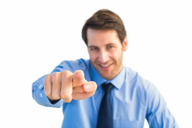 Friendly businessman pointing at the camera