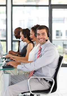 Friendly businessman working in a call center