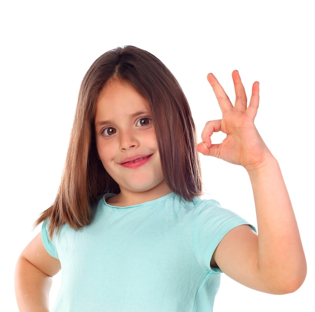 Friendly child saying ok with her hand