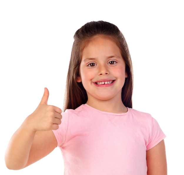Friendly child saying ok with her thumb