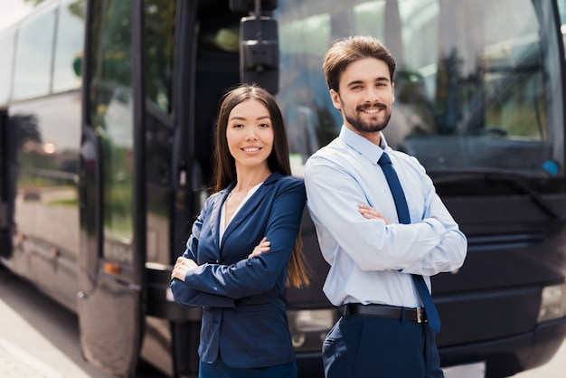 Friendly crew of travel bus professional service.