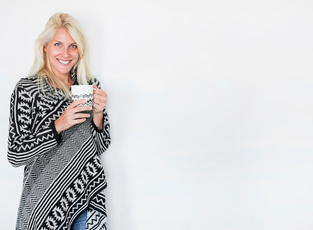 Friendly lady with hot drink