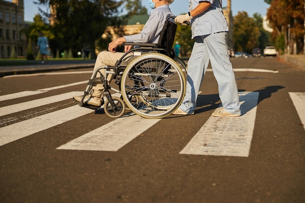 Friendly people walking with wheelchair in the city