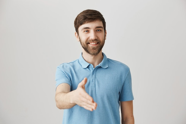 Friendly young bearded man posing