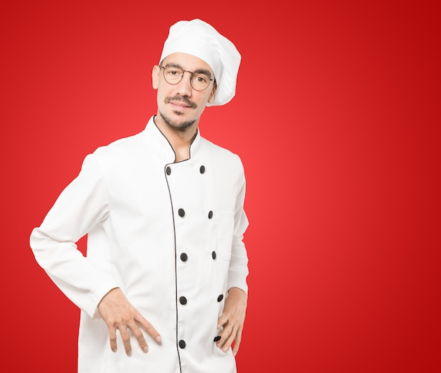 Friendly young chef doing a gesture of admiration