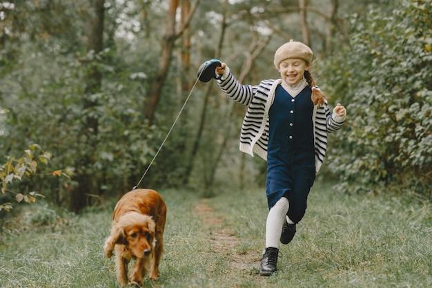 Friends are having fun in the fresh air. child in a blue dress.