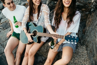 Friends at the beach with guitar