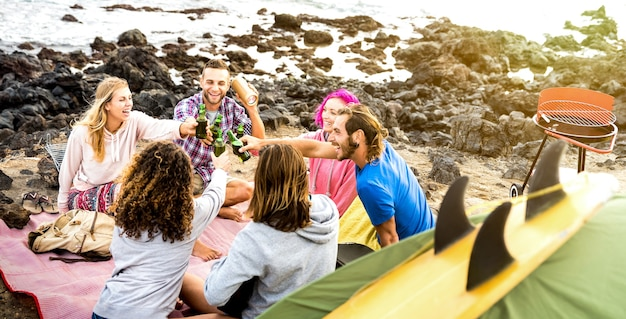 Friends backpackers having fun together at beach camping party