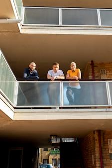 Friends on balcony full shot