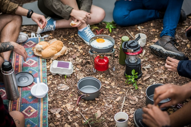 Friends camping in the forest together
