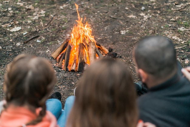 Friends camping with bonfire