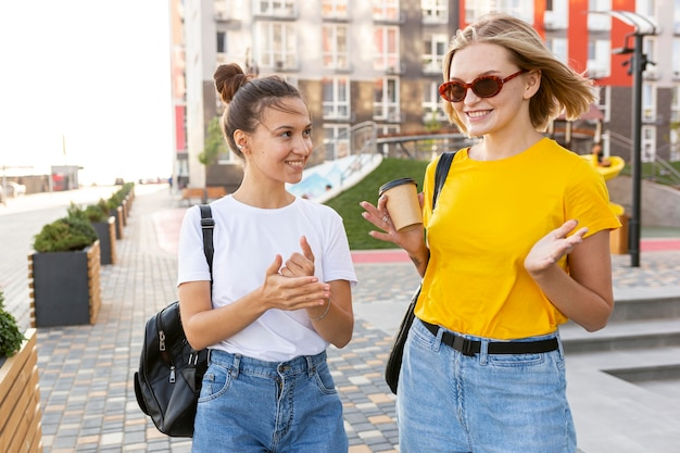 Friends in the city using sign language