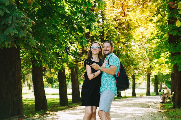 Friends or couple of lovers making selfie photo on motion camera in park ljubljana slovenia
