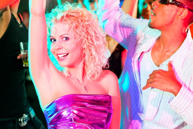 Friends dancing in club or disco